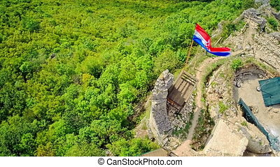 Croatian flag on Necven ruins, aerial - Copter aerial view...