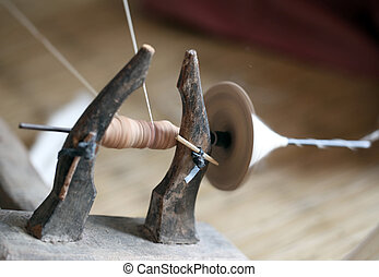 distaff, spinning yarn on an old spinning wheel