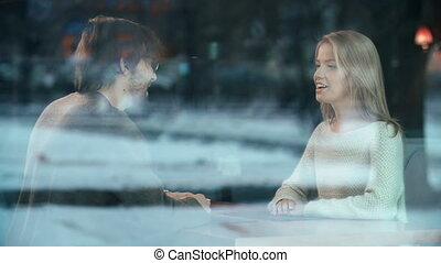 Romantic Date - Through the window shot of couple in love...