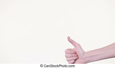 Gesture of approval - Girl shows on white background gesture...