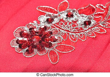 flowers applique - red material with flowers applique