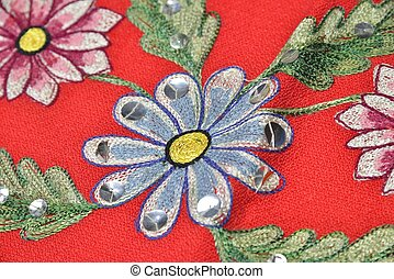 red material with flowers applique