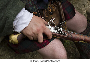 Flintlock pistol - Close up of a flintlock pistol being held...