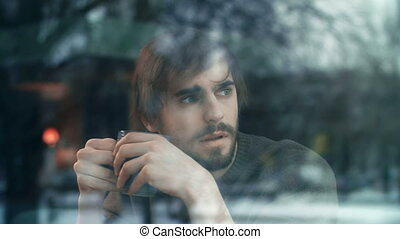 Melancholic Man - Pensive guy with cup of tea looking...