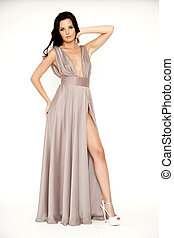 Young slim sexy woman in brown dress isolaten on white...