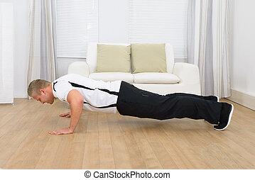 Muscular Man Doing Pushups - Muscular Sporty Man Doing...