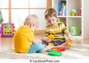children with toys in playroom - children play with...