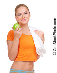 Young smiling woman with apple isolated