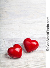 Red hearts on table valentine background - Red hearts on...