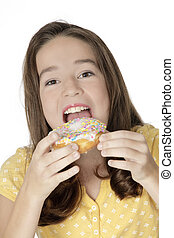 Caucasian Child - Cute Caucasian girl eating a donut on a...