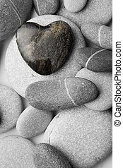Heart Shaped Pebble on the Beach - A single heart shaped...