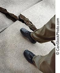 Walking on Broken Dangerous Sidewalk - Man walking on broken...