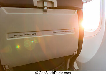 Seated sign on airplane fasten seat belt