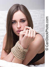 model tied up with fetish restraint rope. - Beautiful model...