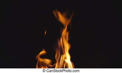 Slow motion of fire over black, with crackling sound,...