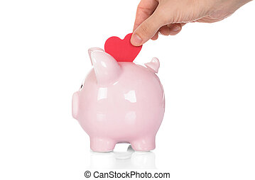 Hand Deposit Red Heart In Piggy Bank - Close-up Of Hand...