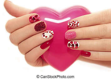 Manicure with hearts. - Manicure with rhinestones in the...