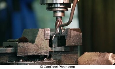 milling machine in action - rotating milling cutter cuts the...