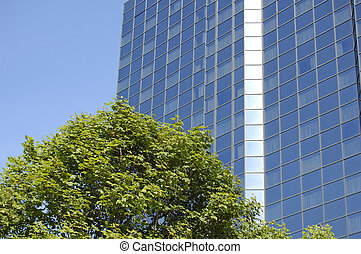 Glasgow-06-0112 - trees in front of blue skyscraper in...