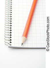 Lead pencil on notepad. - A close-up of a lead pencil on a...