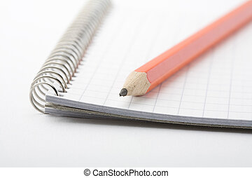 Lead pencil on notepad - A close-up of a lead pencil on a...