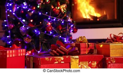 Dolly shot of a Christmas gifts with fireplace in the...