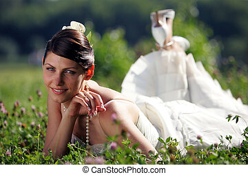 Bride in summer field