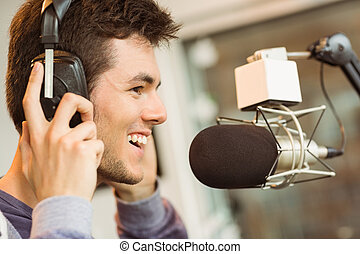 Portrait of an university student recording audio in a...