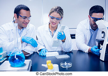 Science students working together in the lab at the...