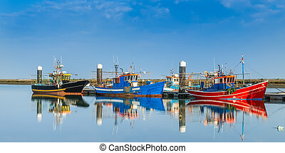 Fishing boats moored at the dock Industrial ships
