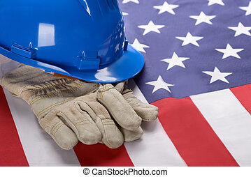 Hardhat And Gloves On American Flag - Close-up Of Blue...