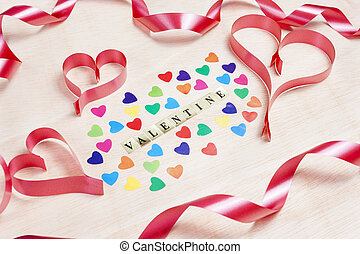 Valentine background written with hearts and ribbon