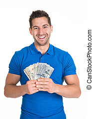 Man Holding Fanned Us Paper Currency - Portrait of smiling...