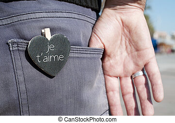 je t aime, I love you in french - a heart-shaped chalkboard...