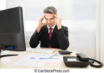 Worried Businessman - Worried Mid Age Businessman Sitting At...
