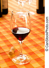 Glass of red wine in the rustic tablecloth - good wine in...