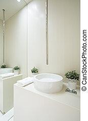 Designed faucet inside white bathroom - View of designed...