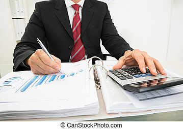 Businessman Analyzing Graph - Close-up Photo Of A...