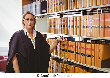 Portrait of a serious lawyer with reading glasses