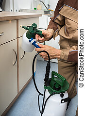 Pest Control Worker Holding Pesticides Sprayer - Close-up Of...