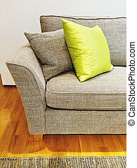 Gray sofa with cushions in the living room. Modern...