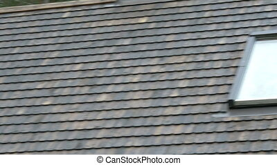 The wooden shingles of the rooftop with window - The ecoroof...