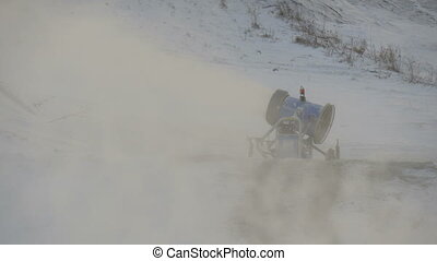 A high pressure blowing of snow by the snow blower on the...