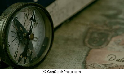 Left angle view of the compass and the book - Left angle...