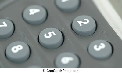 Number pins of a calculator from 0-9. Calculator is used for...