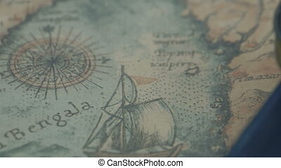 The compass and the bible on the map showing the details of...