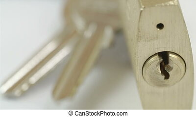 A padlock and the keys It is golden brown in color used to...