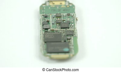 The chipboard of the USB storage with small wires inside. A...