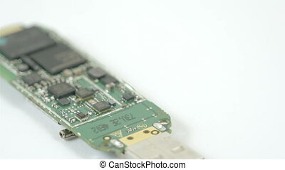 A USB chip with small chipset on it It is the inside look of...