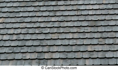 Tiles of the newly constructed shingle roof